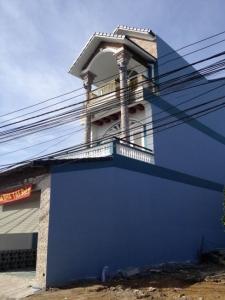 Nhà dĩ an ngay trung tâm thị xã bán gấp , thiết kế 2 làu tiện kinh doanh.