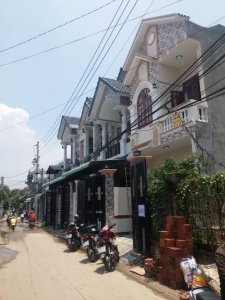 Bán nhà ngay QL1k gần nhà thờ Bình An sổ hồng riêng vị trí đẹp!